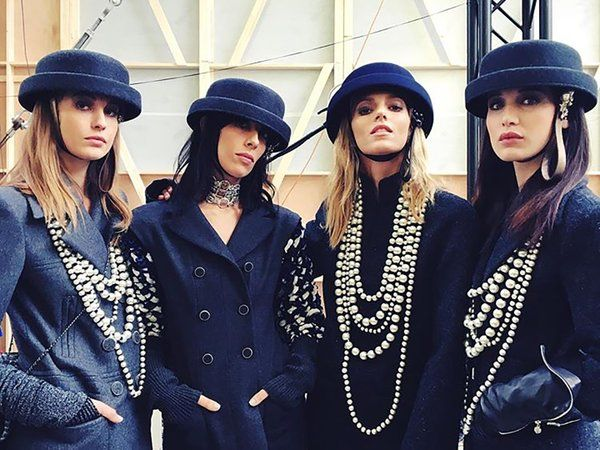 16ced19d38d Pearl Necklaces  Karl Lagerfeld accessorized the silhouettes of the   ChanelFallWinter2017 show with layers of pearls