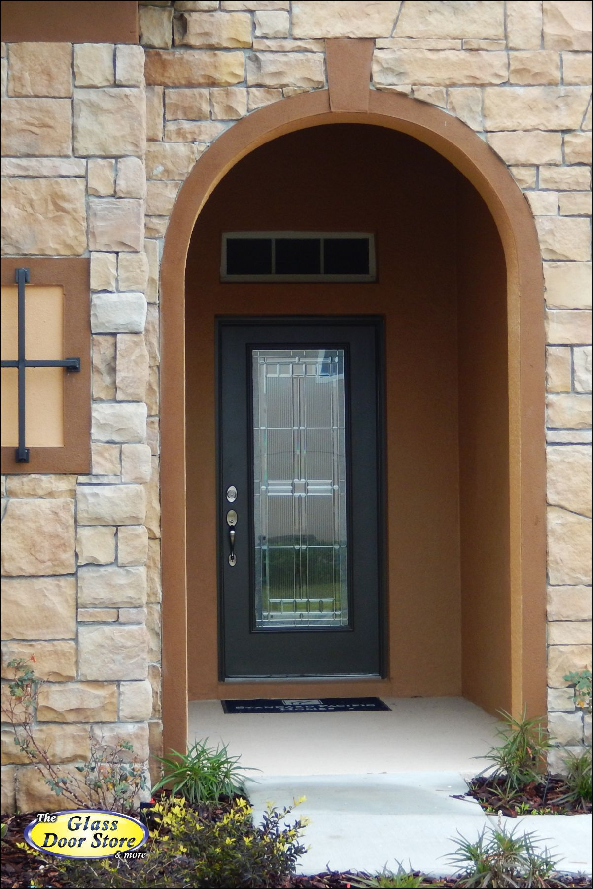 Round top front door window inserts - Single Door Insert With Square Pattern In Front Entry With Arched Opening