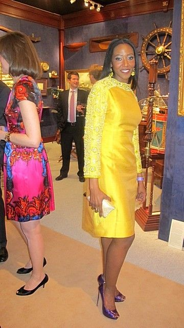 The Greatest Show on Earth: NYC's 59th Winter Antique Show of Course!            An apparition of impossible splendor, Ms. Keita Turner, in yellow, pearl-beaded silk shantung,  with purple slippers.