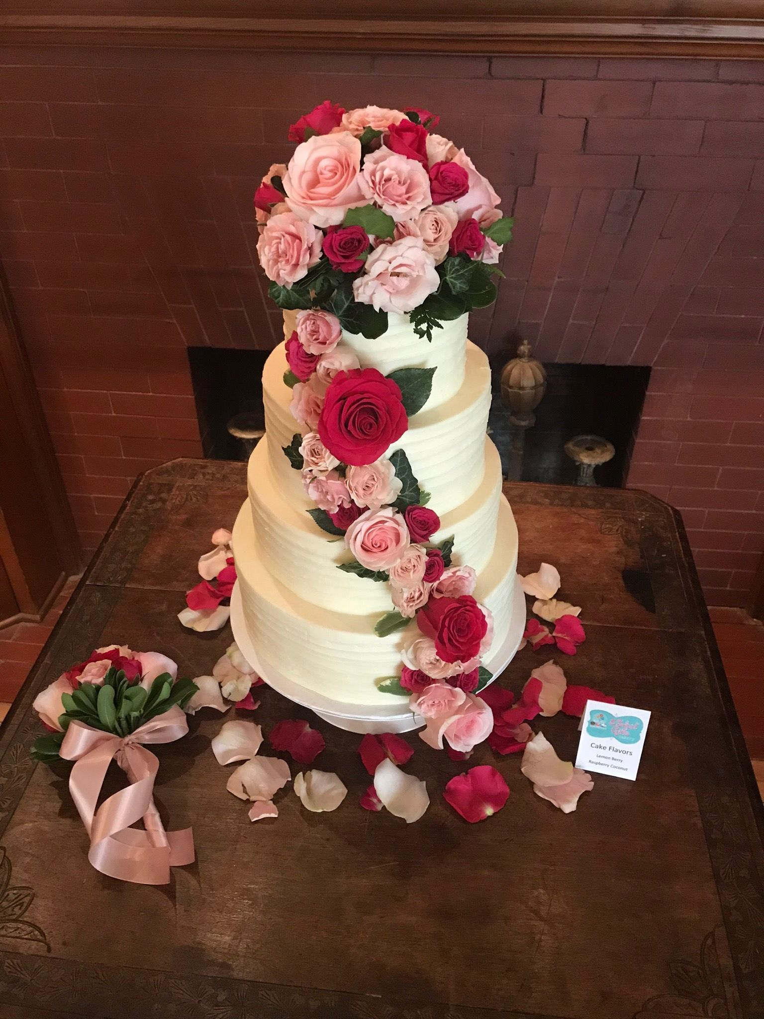 White Buttercream 4 Tier Cake With Pink And Red Roses By 3 Sweet Girls Cakery Cake Tiered Cakes Wedding Dessert Table