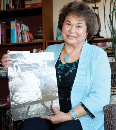 Trib Photo/Sue TonePrescott Valley resident Patricia Tiber survived three years in a Japanese concentration camp on Java and five more years of Indonesia's bloody fight for independence - a part of WWII history of which many people are unaware. She holds a book written in Dutch about all the internment camps during the war.