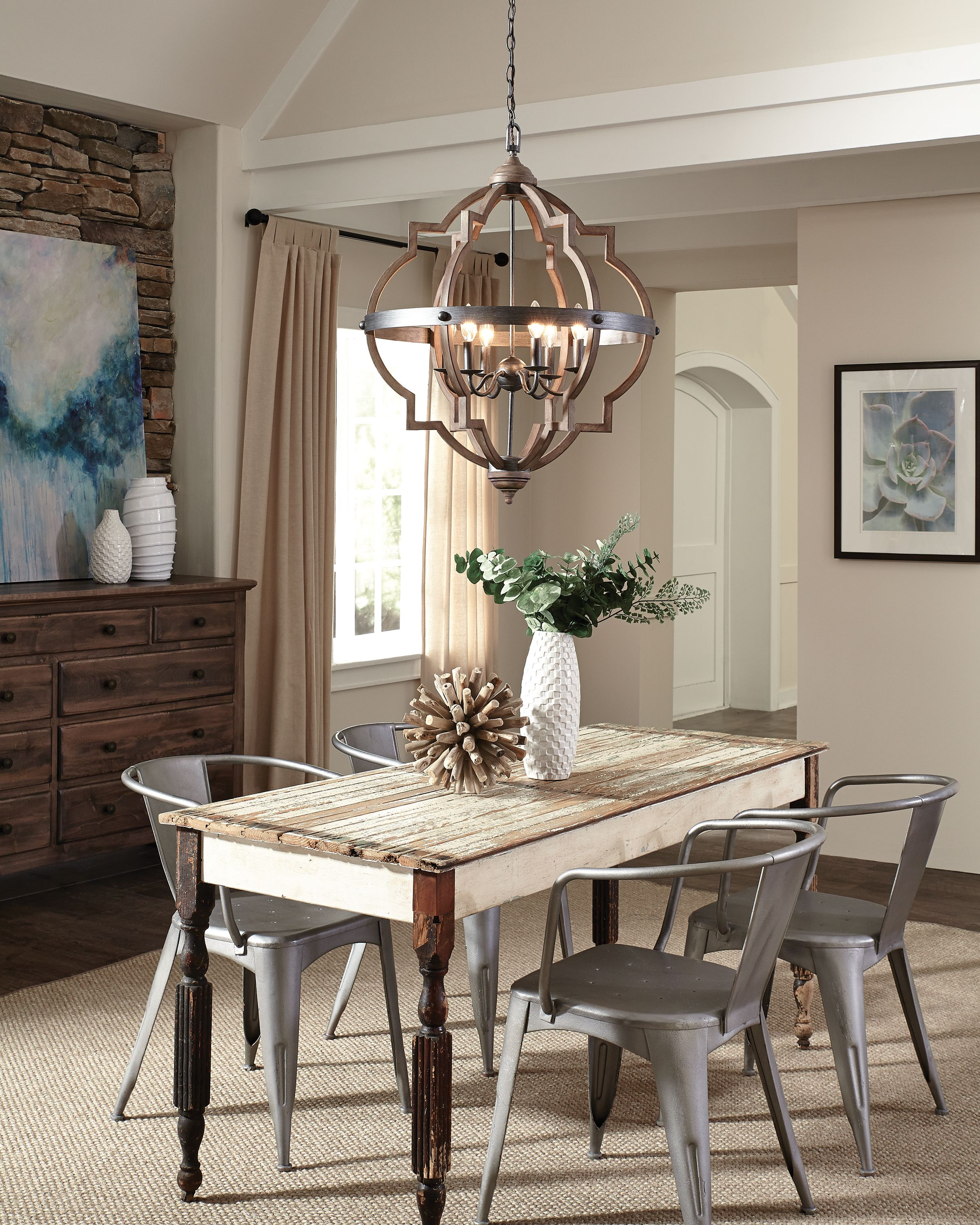 Wood and Metal element make this dining space complete. Find this lighting  fixture at https