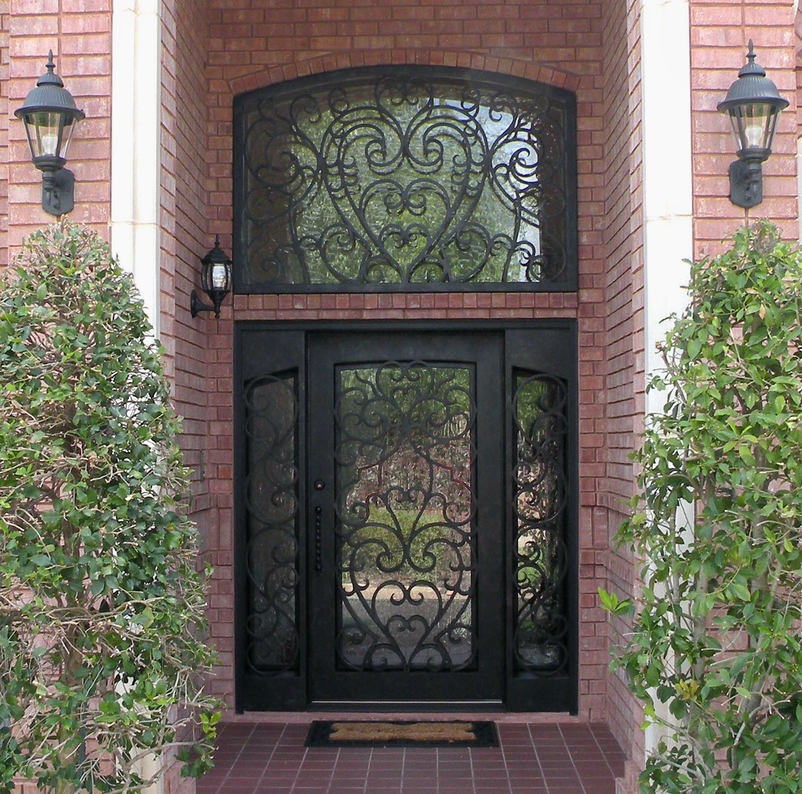 Custom heart scroll iron door with sidelights and transom for Custom transom windows