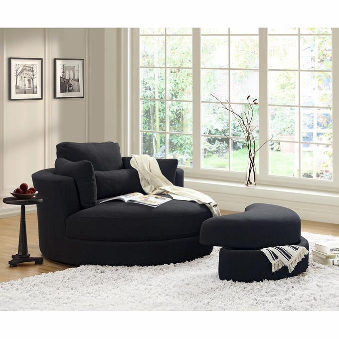 turner fauteuil enveloppant pivotant noir avec pouf. Black Bedroom Furniture Sets. Home Design Ideas