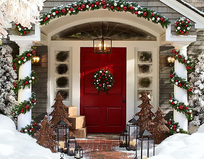 A big front door, sidelights and an arched window entry