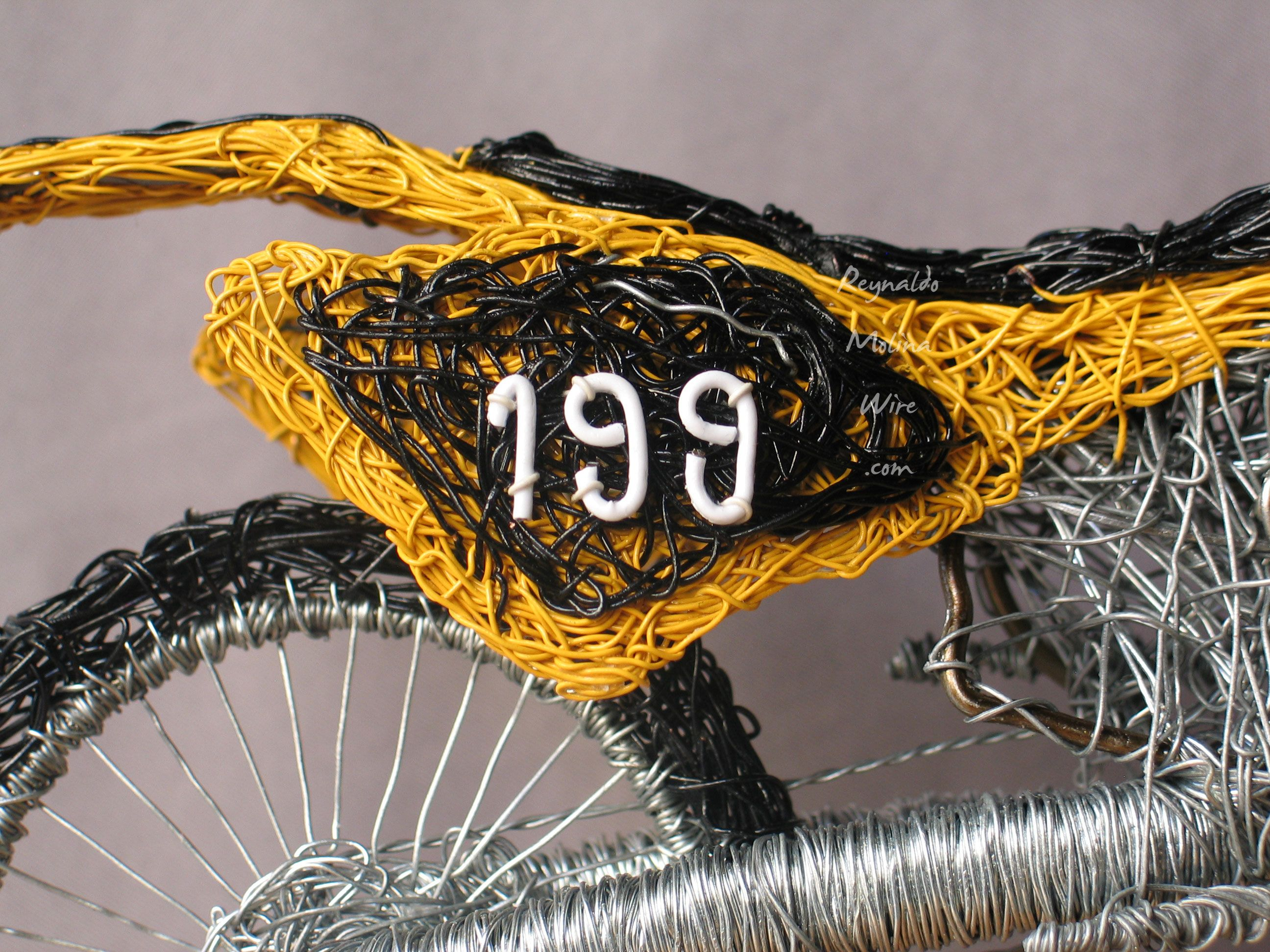 close up view of wire sculpture of travis pastrana dirt bike