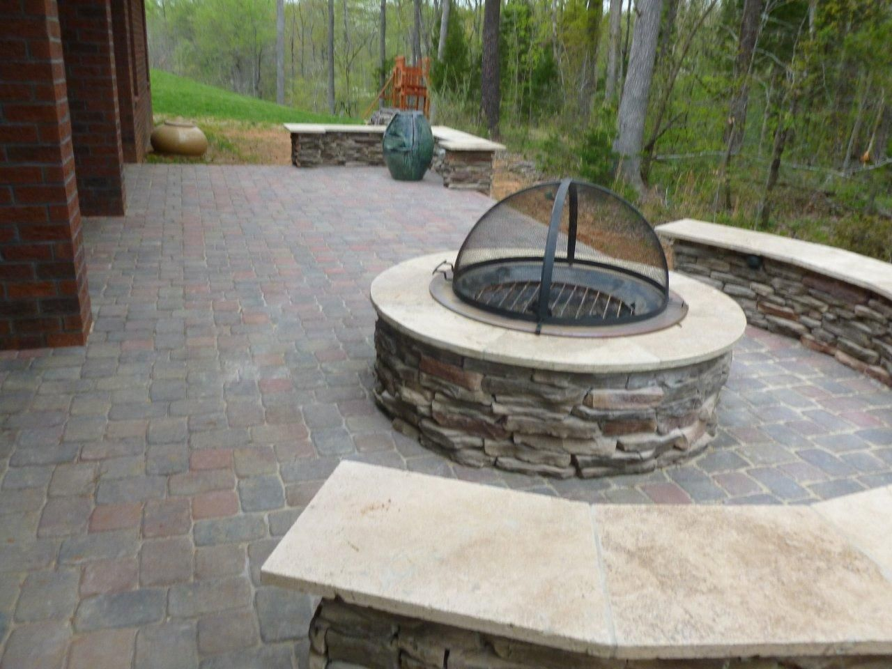 stonefire pit with cover on paver patio in charlotte nc