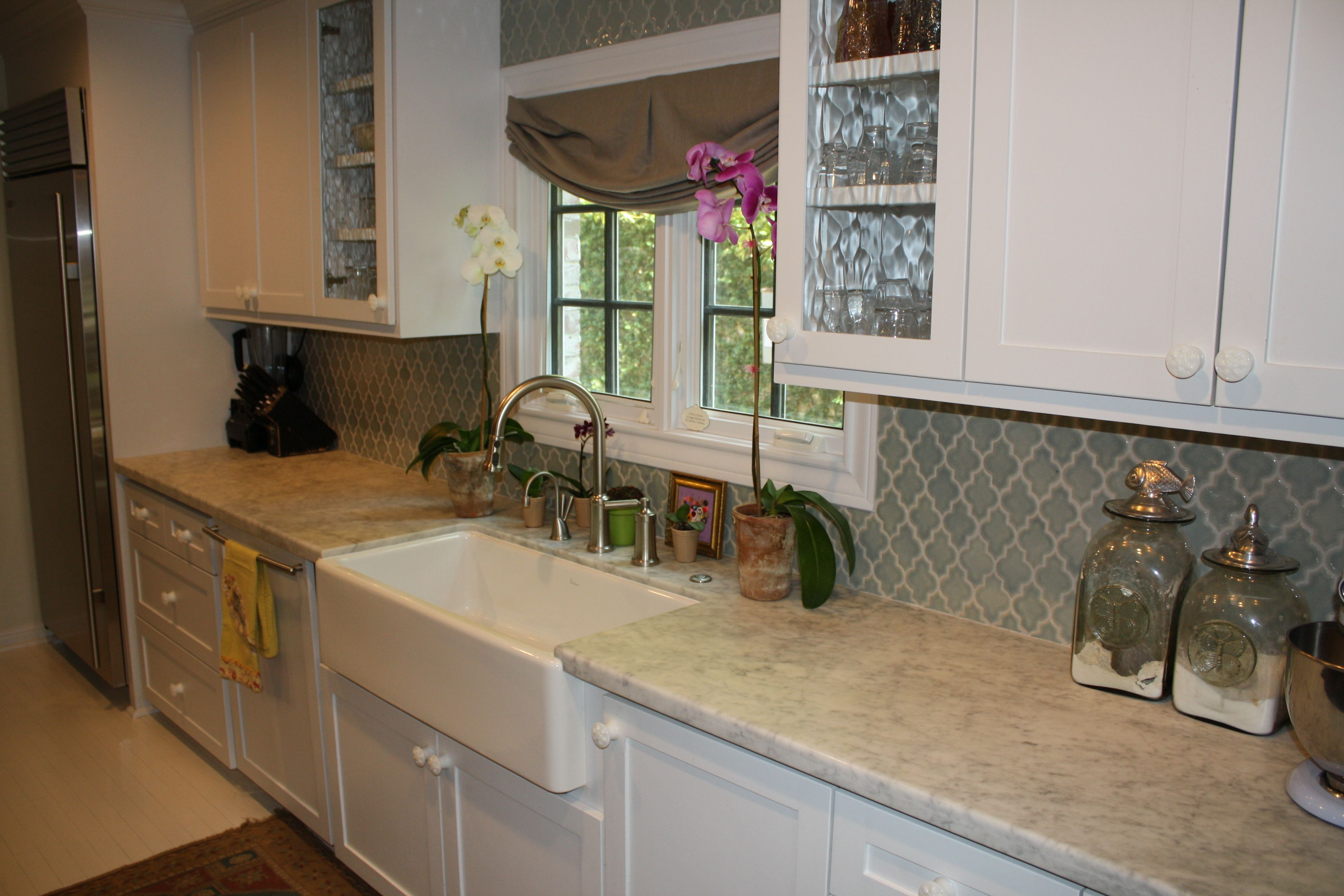 Cute country kitchen with pastel green back splash, white