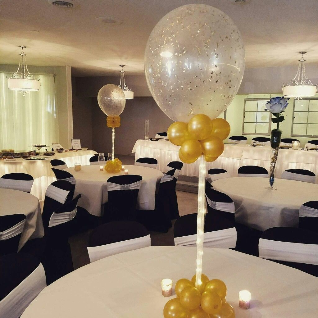 Glitter balloon centerpieces w rice lights by