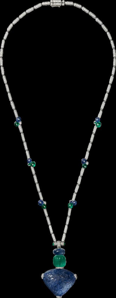 CARTIER. Collier / Pendentif - platine, un saphir de Birmanie gravé de 110,29 carats, une émeraude de Zambie côtelée de 18,42 carats, émeraudes gravées, saphirs gravés, diamants taille brillant. #Cartier #CartierMagicien #HauteJoaillerie #FineJewelry #CarvedStones #TuttiFrutti