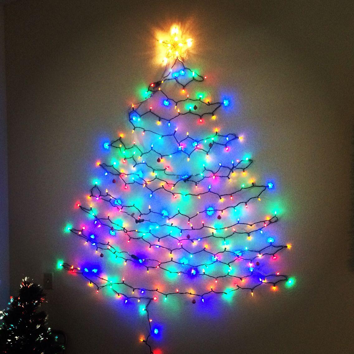 christmas tree out of christmas lights on the wall