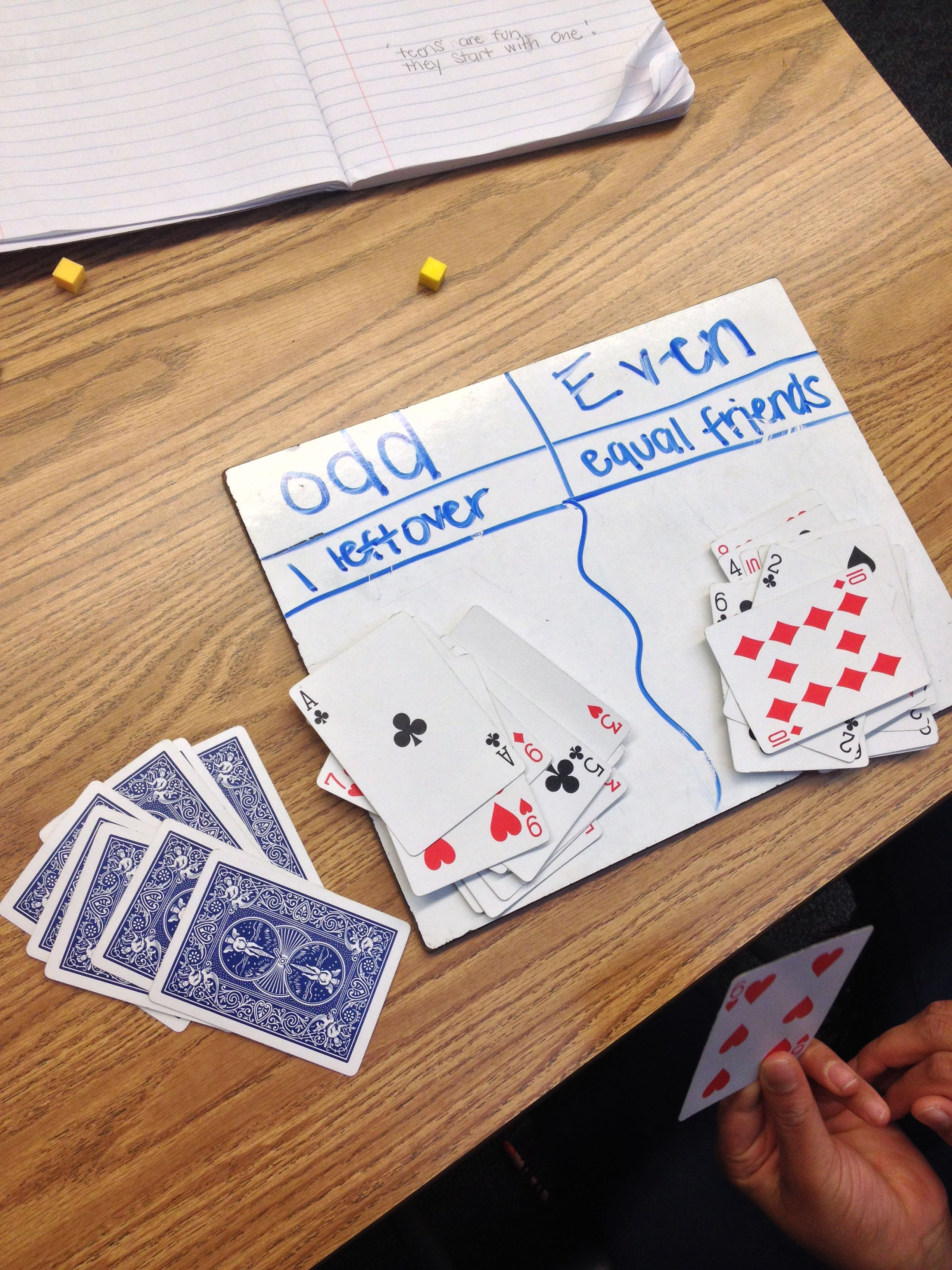 The Odd and Even Card Game. Make a t chart explaining the