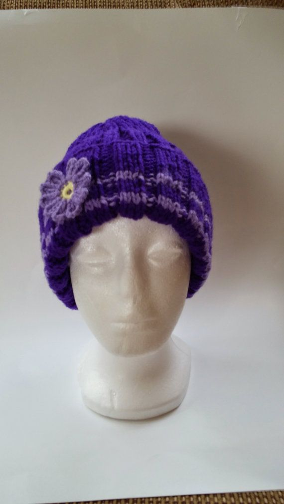 Hey, I found this really awesome Etsy listing at https://www.etsy.com/listing/215406836/warm-hand-knit-hat-crocheted-flower