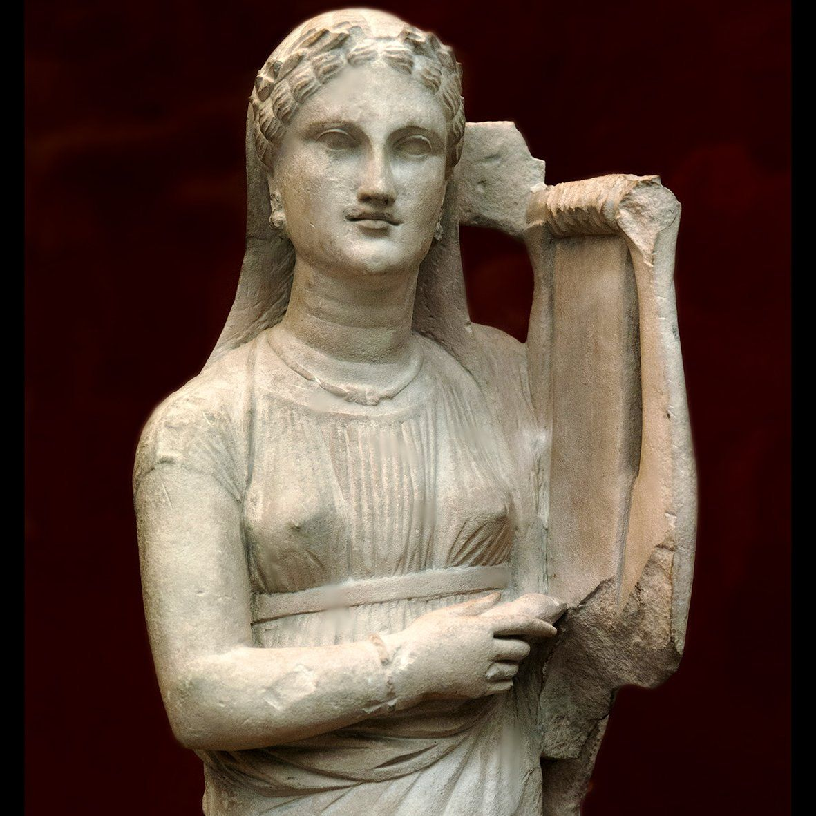 Ancient Greek Statue of Female playing Lyre She wears ...
