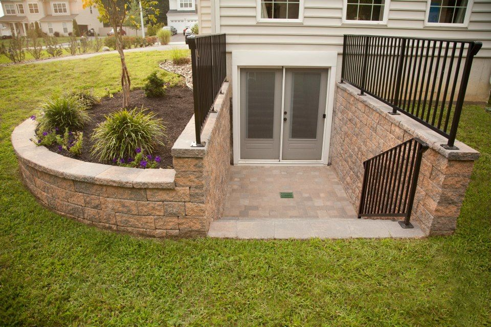 Custom egree from basement with landscape walls by Darlington ...