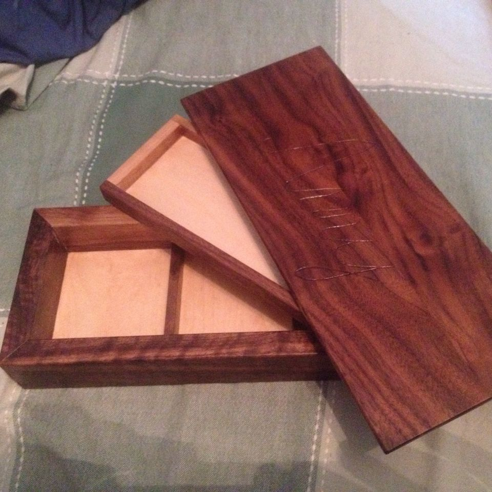 My first jewelry box Made of walnut and has a name carved on top