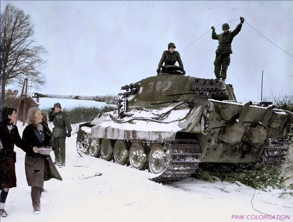 Two American soldiers inspect a destroyed German B (H) 'Tiger II' Nr. 312. (Belgium, 1944).