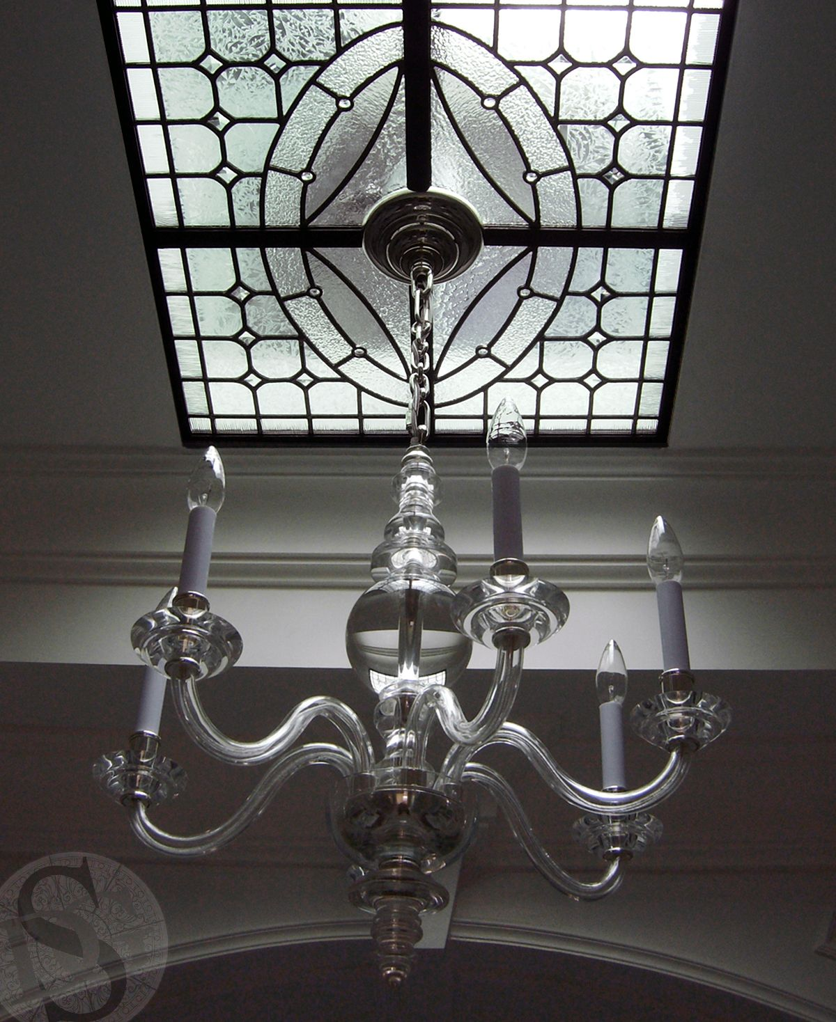 A Simple Leaded Glass Panel Sets The Stage For Chandelier In This Traditional Style Home