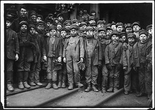 Breaker boys working in Ewen Breaker. S. Pittston, Pa, January 1911 | by The U.S. National Archives  Lewis Hine was a New York City school teacher and social documentary photographer. In 1911, he was hired by the National Child Labor Committee to document child labor abuses in America. His heart-wrenching images of children at work helped lead to the passage of new labor laws in the United States.