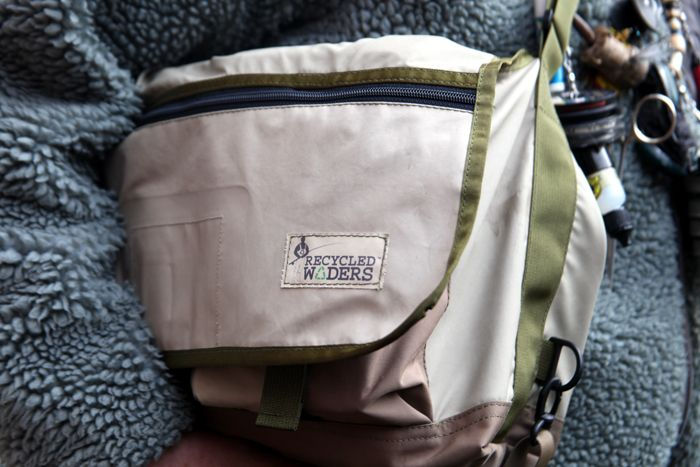 The Recycled Waders Creel.  Made in Seattle, Washington from old leaky waders, this is our choice for on water management of fly fishing necessities.  Boxes, rain jacket, lunch and first aid kit with a lanyard and you are set!