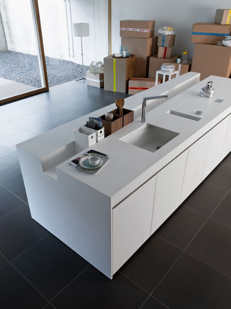 The recess in the counter is sheer genius. So is the sliding sink ...