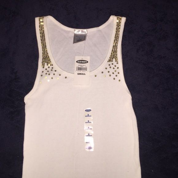 611722b5341c9 New white tank top with gold sequins. NWT Old Navy tank top with gold  sequins. 100% cotton. Machine washable. Old Navy Tops Tank Tops