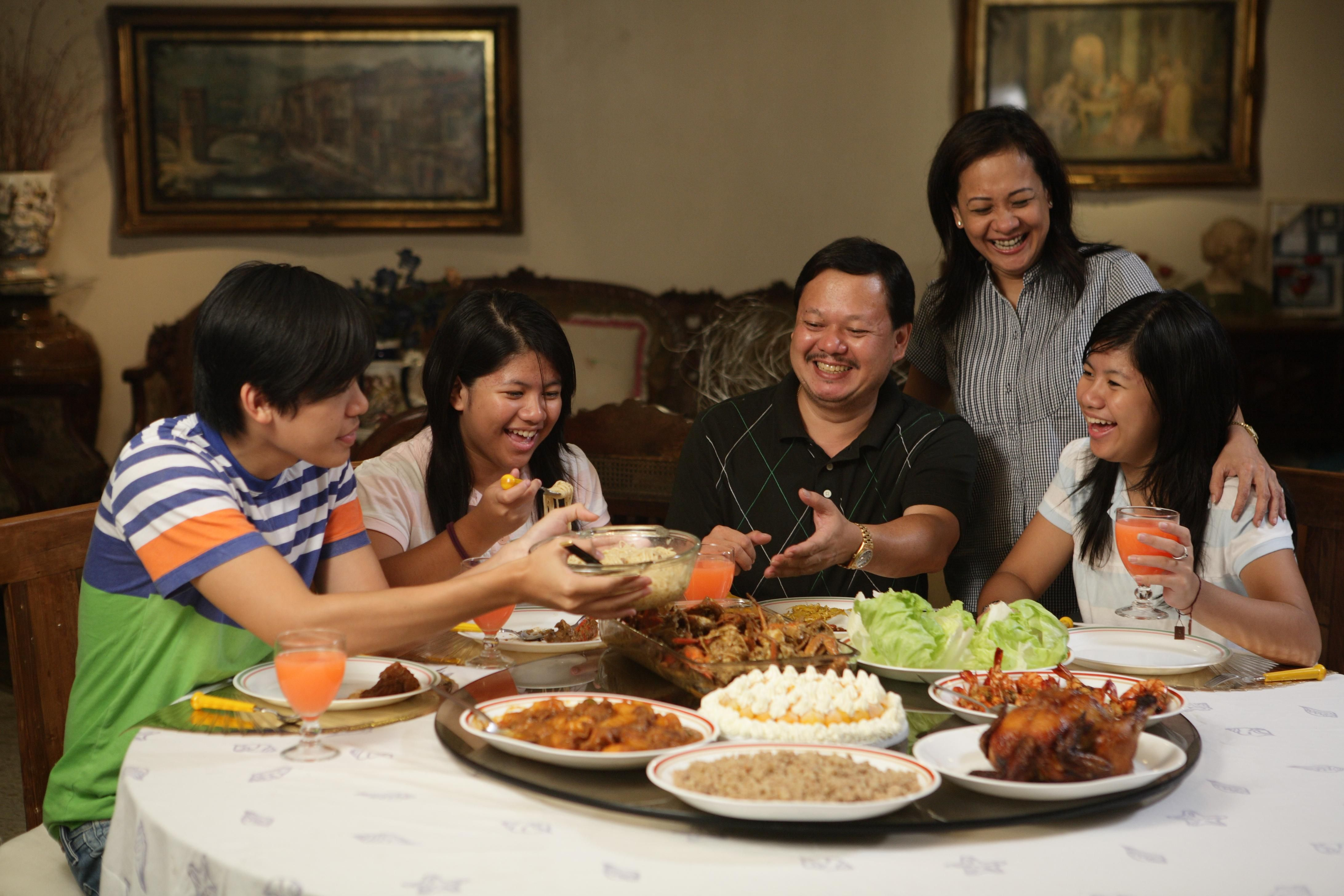 Daily Life: Above is a picture of a family eating. As you ...