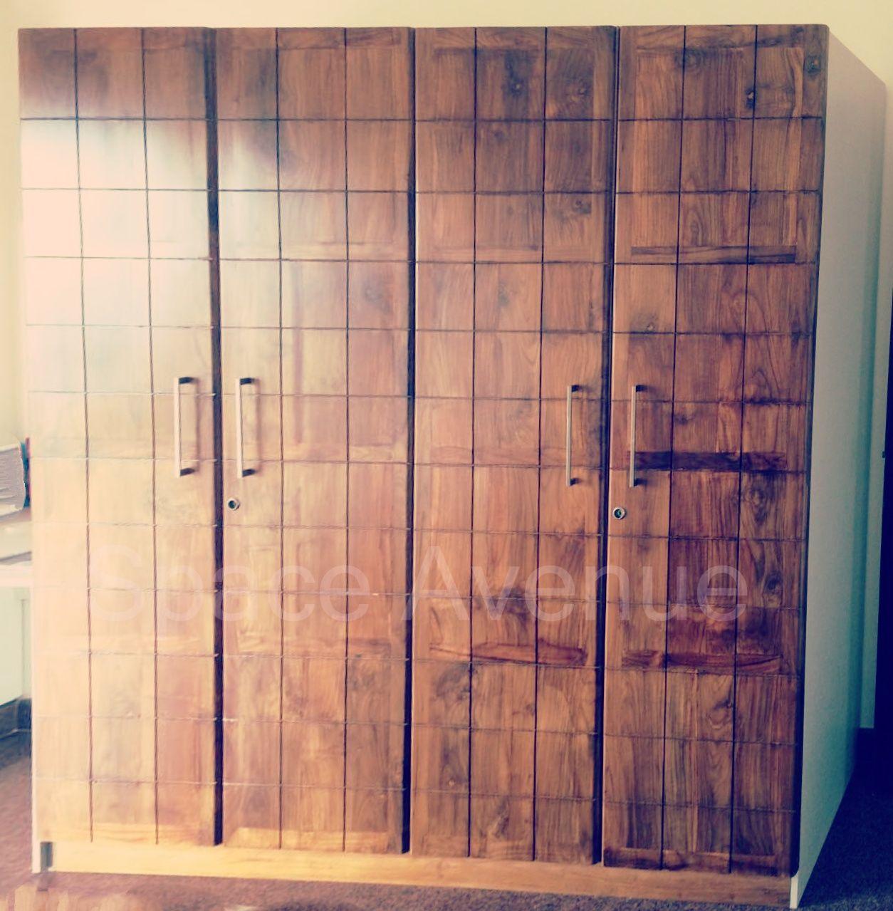 Living Room Interiordesign Bangalore: Wardrobe With Solid Wood Shutters #ModularWardrobe
