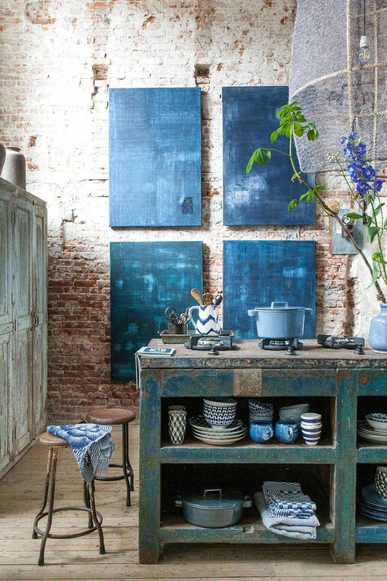 Kitchen With Brick Walls And Blue Motif