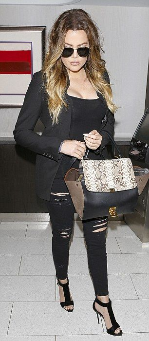 2a1a1e897c0 ... Khloe Kardashian donned a sheer black top that revealed her ample  cleavage and slinky black bra