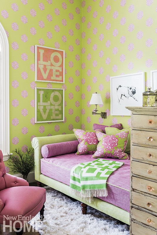 The spare bedroom is a favorite refuge, with bold wallpaper whose chartreuse and purple are repeated in the daybed.