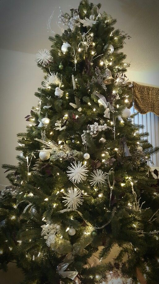White tree with purple and lime green accents, beautiful Christmas tree. Molbaks decorations!