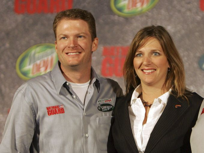 Dale Earnhardt Jr., left, and his sister Kelley Earnhardt, center, pose for a photo in 2007. Kelly Earnhardt co-owns JR Motorsports with Dale Jr.