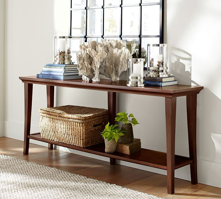 long console table with window frame backin great room
