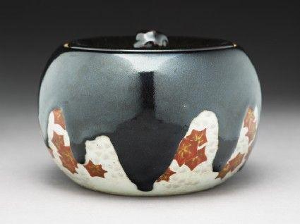 Mizusashi, or water jar, with maple leaves. Japan. Ashmolean.