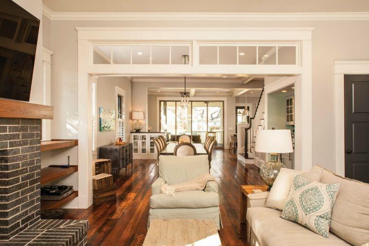 pavimento in parquet, parete con mattoni a vista, divano bianco e ...