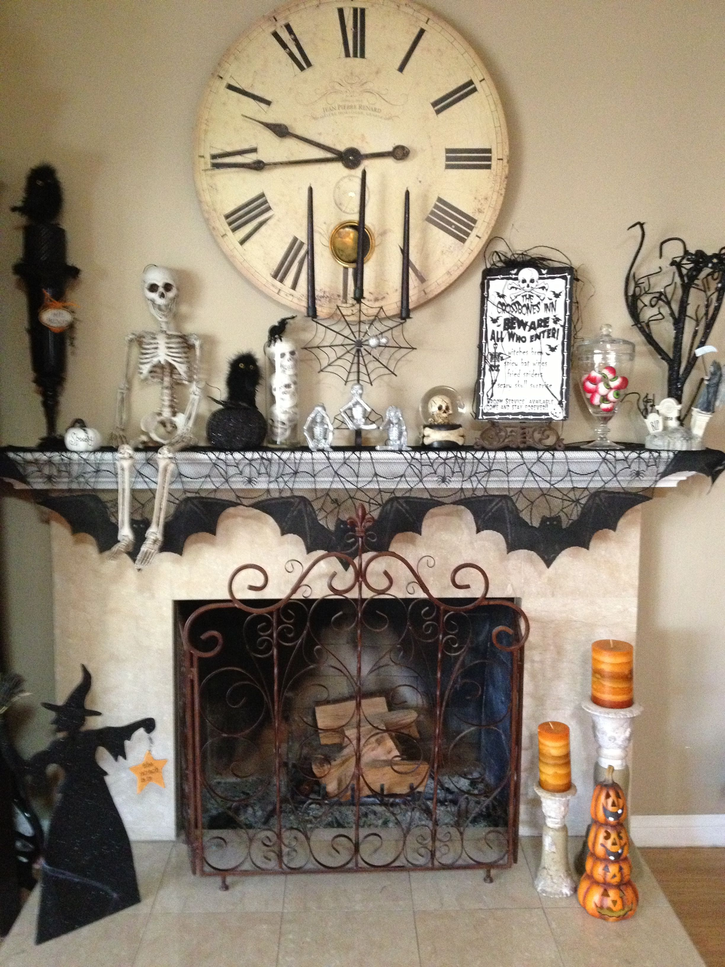Halloween mantle - I need to get some of those twigs for mine - Inside Halloween Decorations