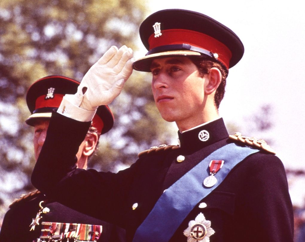 Prince Charles in the uniform of the Colonel in Chief of the Royal Regiment of Wales, salutes, at the Regiment's Colour presentation, at Cardiff Castle in Wales on June, 11, 1969. (AP Photo)