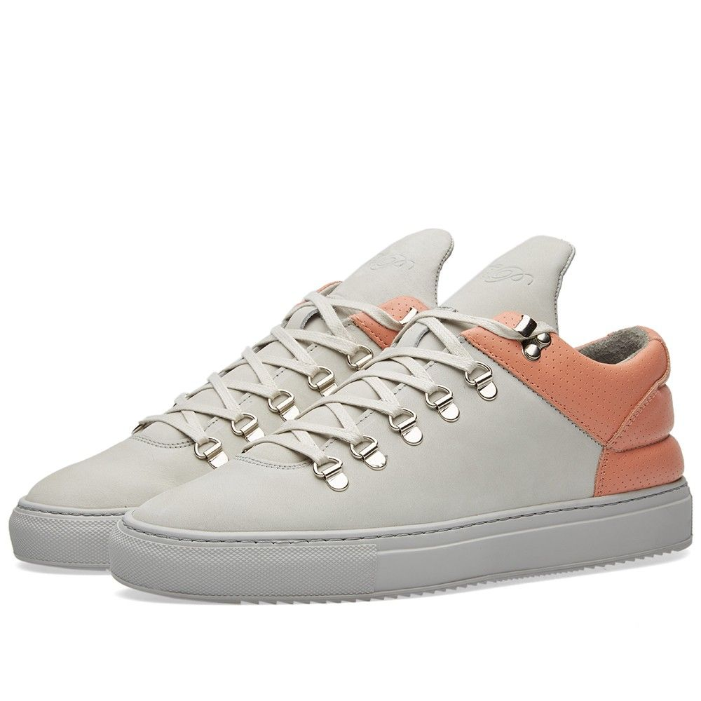 Amsterdam based brand Filling Pieces do exactly what their name intends - fill a gap in the footwear market between street and haute couture, with minimal design and impeccable detailing through high quality product. The Mountain Cut Sneaker is constructed from a tonal premium leather with a contrasting heel tabl. The upper finished with stitch detailing and features hiking-style D-ring lacing, padded collar and a contrasting vulcanized sole unit.  Leather Uppers Stitch Detailing Silver…
