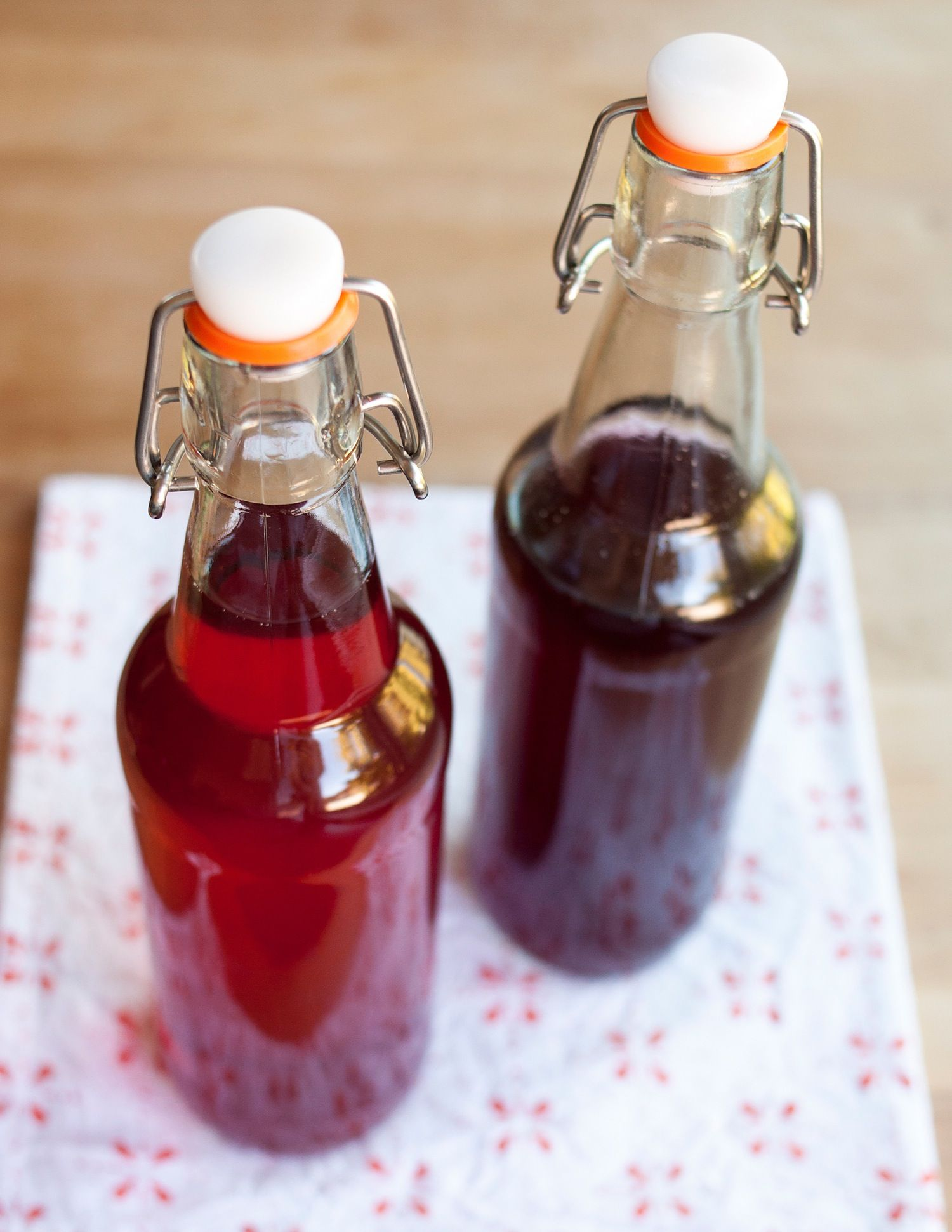 It's no pretty jar of jam or row of canned tomatoes, I know, but I suspect that making your own fruit-flavored vodkas might just be the most fun way to preserve the season! This is also perfect for when you're not in the mood for a big preserving project, but want a quick way to make sure that handful of juicy berries, plump purple figs, or last peaches doesn't go to waste. Because a bottle of jewel-colored, summer fruit-infused vodka will never go to waste. Trust me on this.