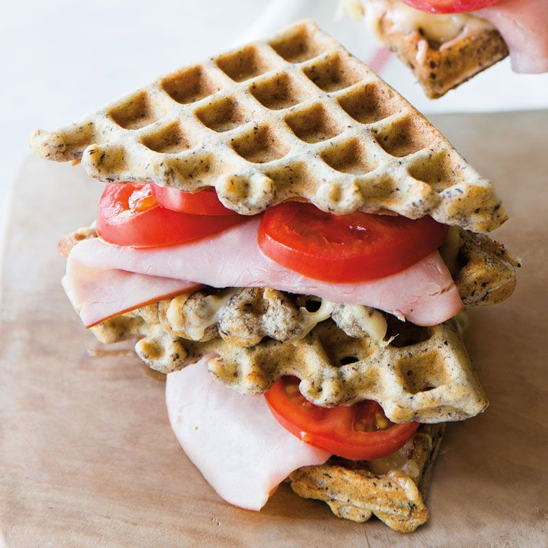 These buckwheat waffles are used as the bread in a ham and cheese sandwich.