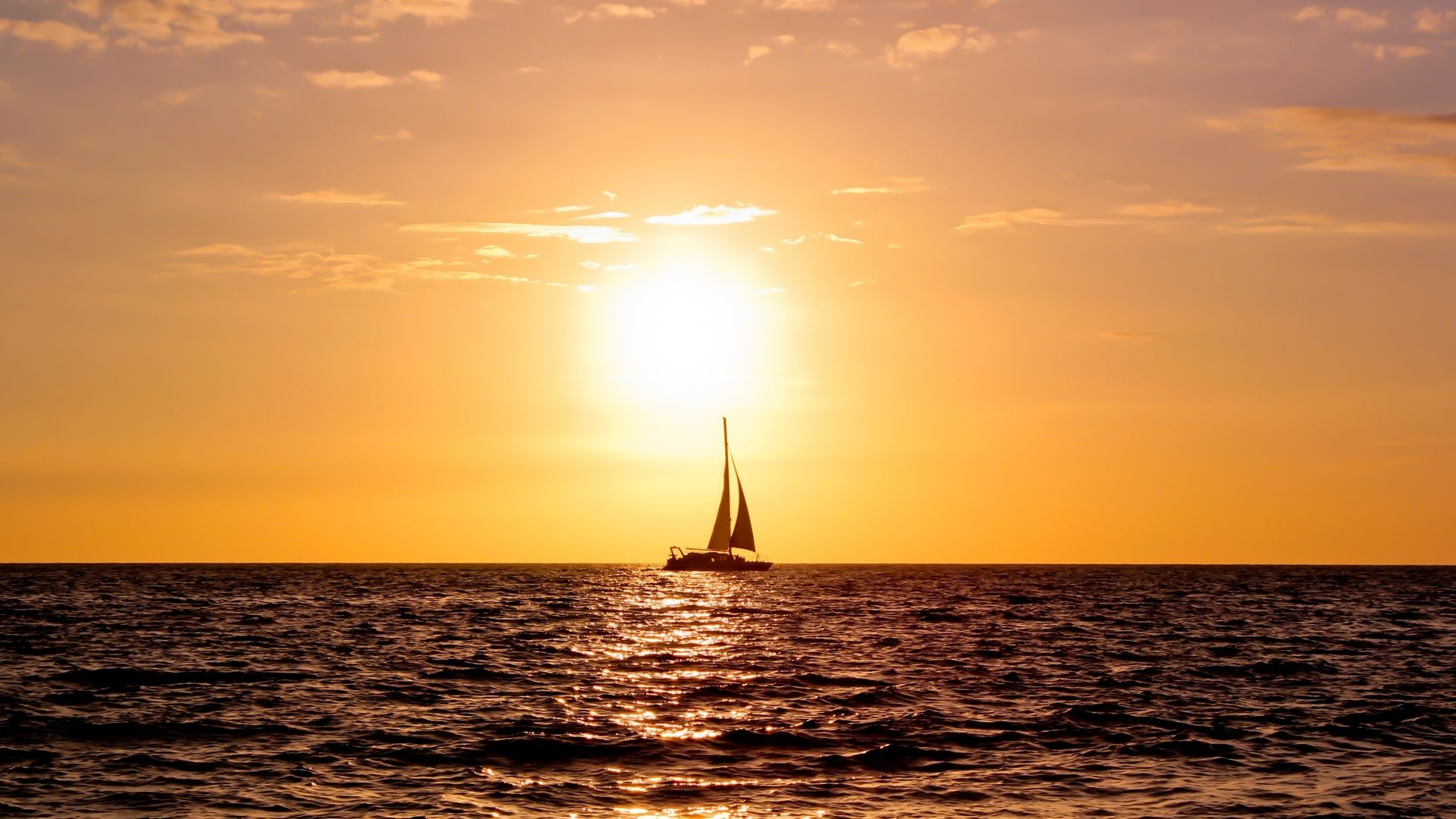 Only boat, ocean and sunrise...