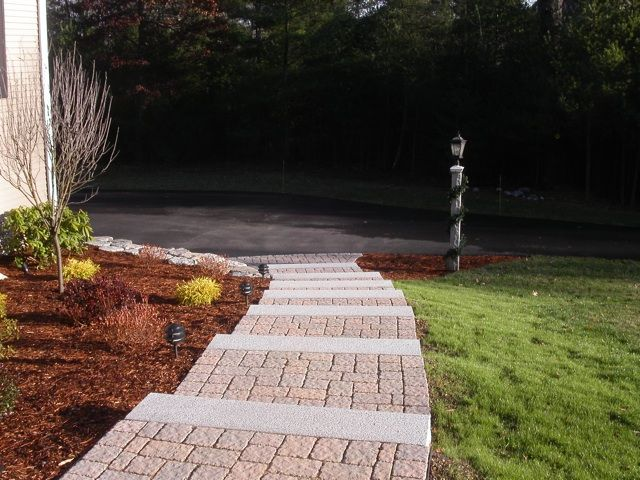 Granite Steps Paver Walkway Granite Wall And Garden All Combine To Create A Grand Entrance To This Home Outdoor Patio Decor Patio Decor Walkway