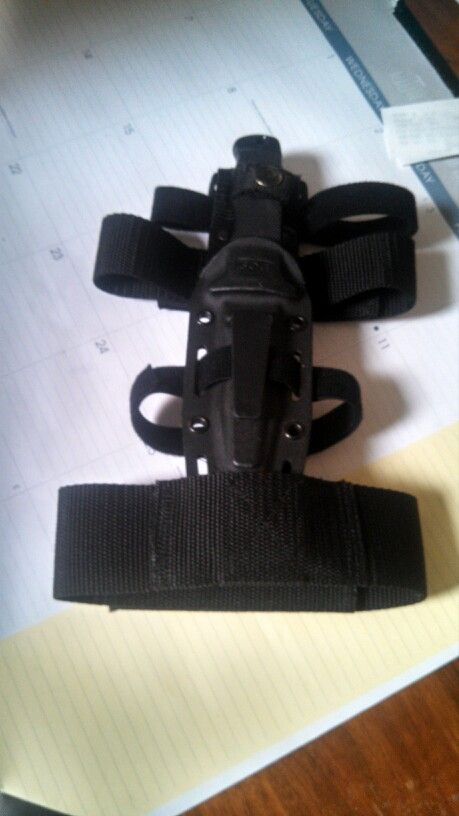 SOG Navy Seal Pup and sheath with a leg strap   I carry this