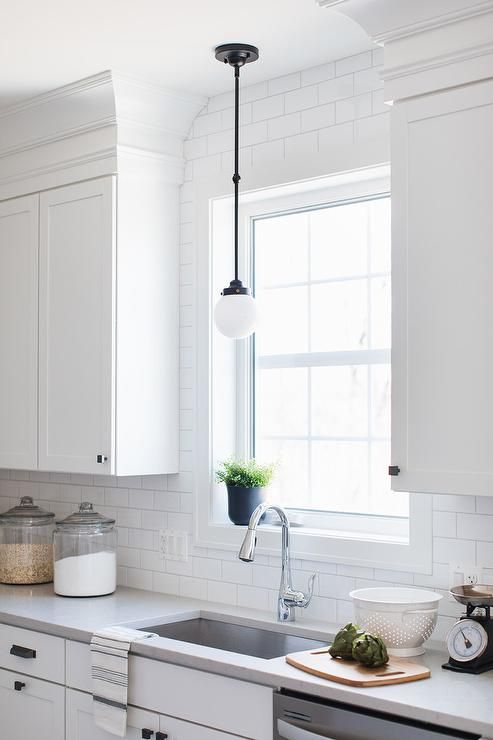 a small white glass and bronze vintage light hangs in front of a rh pinterest com