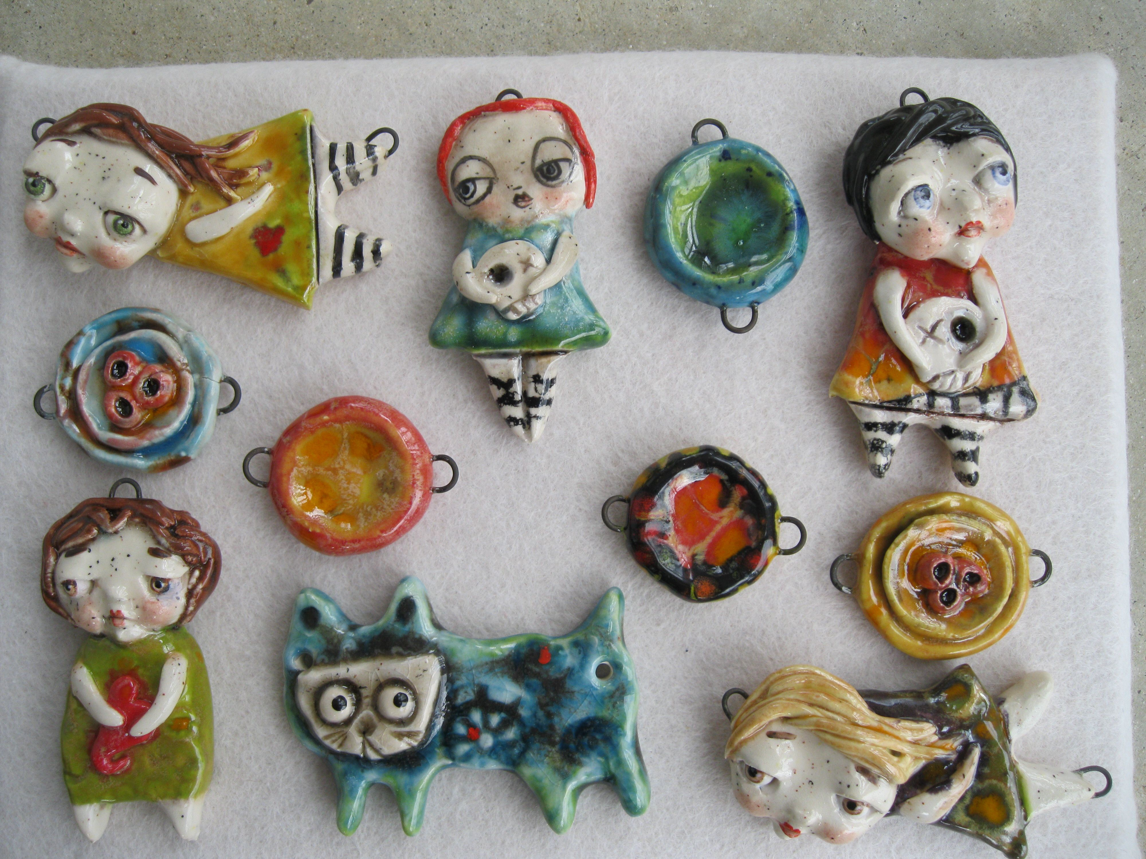 Group of Pendants.  Ceramic, fired about 5 times - by Sunny Carvalho