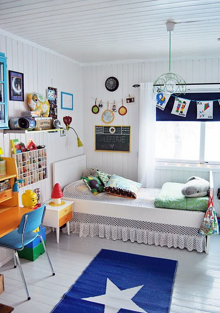 Great kids room\u2014love the white walls and the bright, happy colors