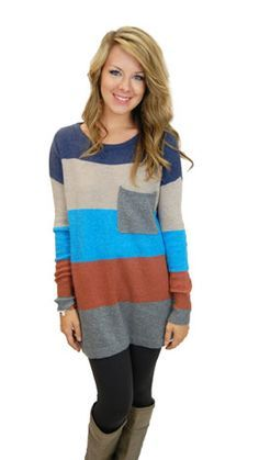Multi-colored long sweater with black leggings and boots. Grab a ...
