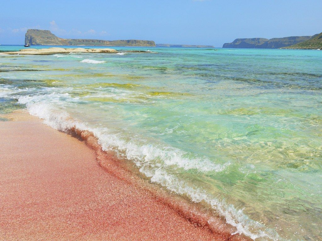 What makes a pink sand beach—a million pieces of shattered coral? A trick of the eye and the light? Discover the best places around the world to see these colorful beaches up close. , Crete, Greece