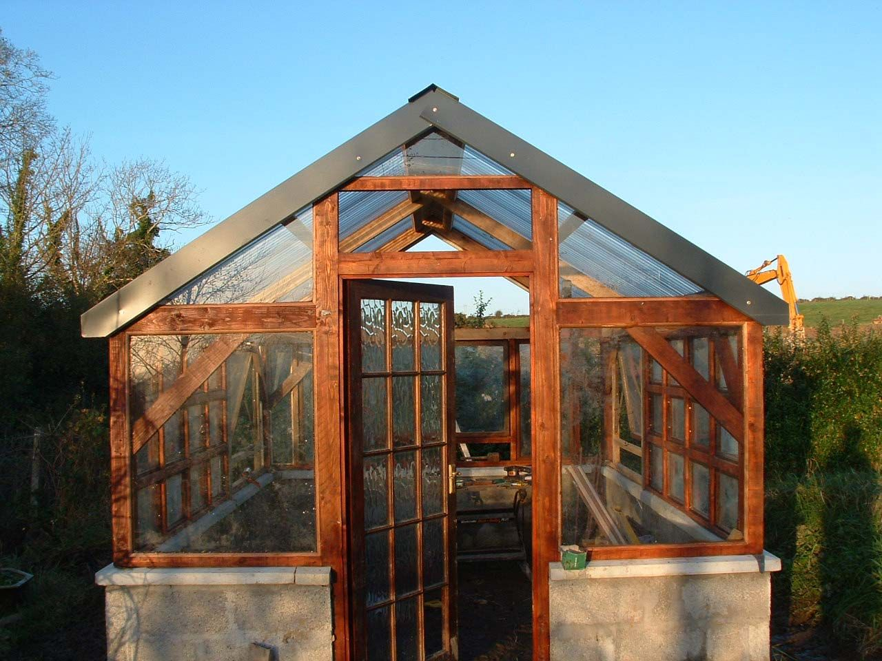 Timber frame greenhouse w recycled windows recycled for Greenhouse house plans